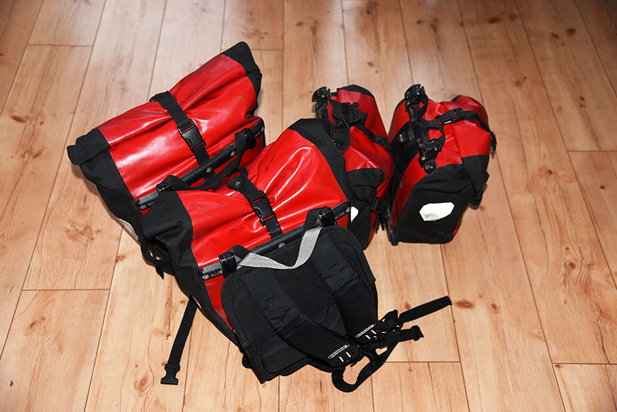 Four ortlieb panniers one used as a hand luggage