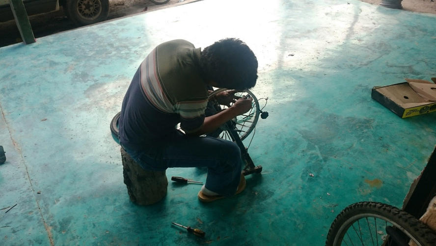 Bicycle repairman at work