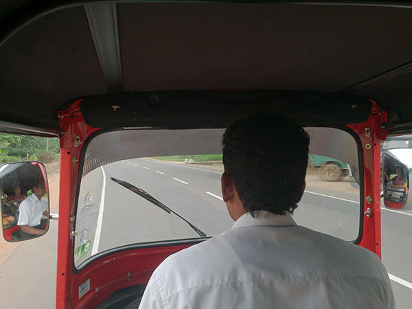 Inside the Tuk Tuk, Mr. Milton driving