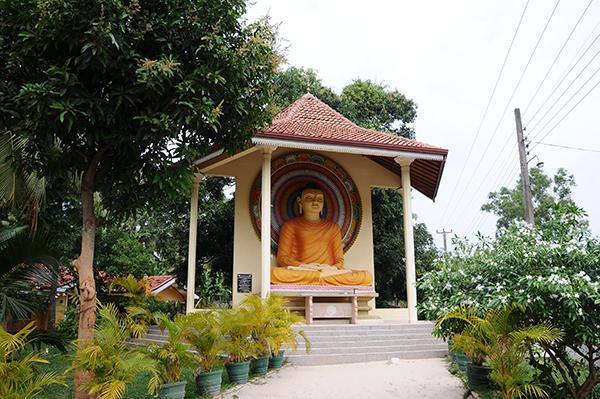 Buddha beside the road