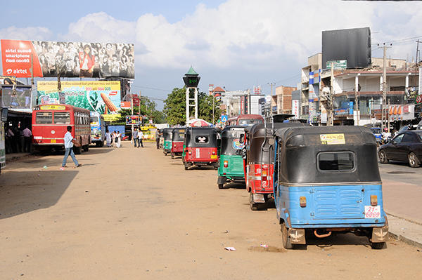 narudhapura bus station ,tuk tuks waiting for passengers
