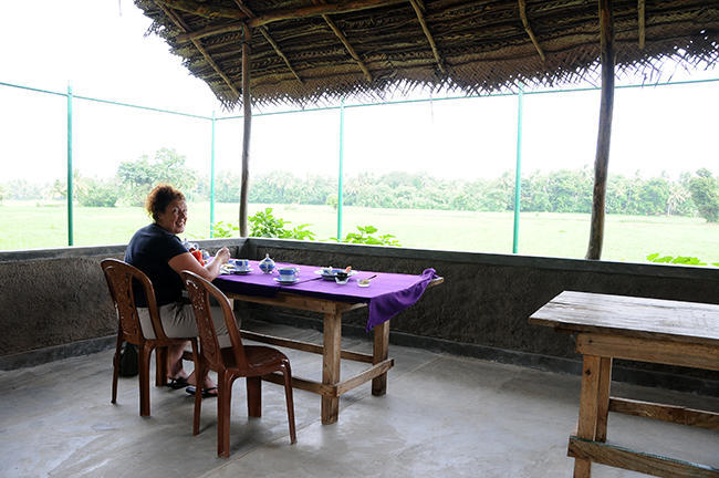 Having breakfast with rice field view