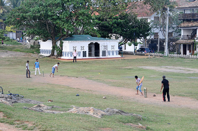 Modern life in the old town: Cricket players