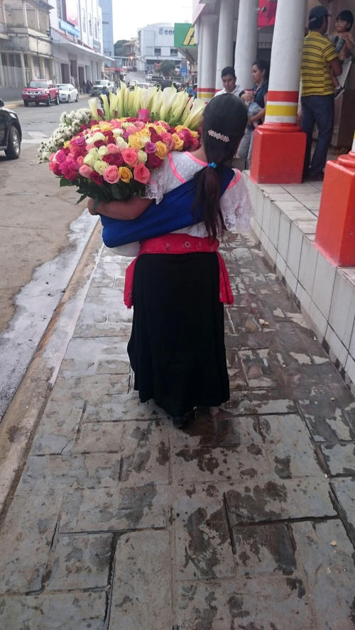 Maya woman selling flowers