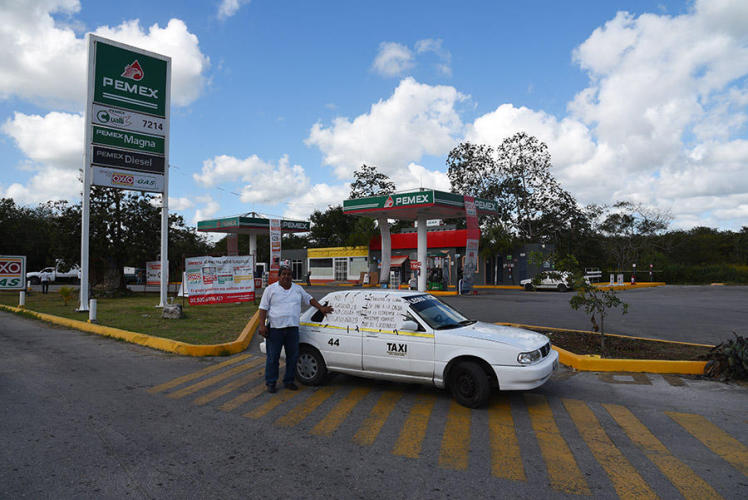 Taxis on strike blocking the Gas station entrance