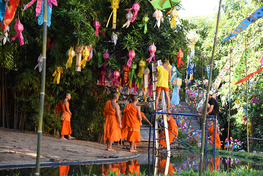 Monks and novices doing some decorations